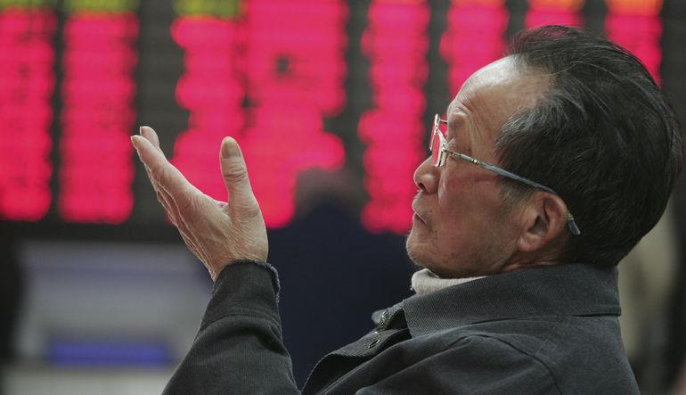 Çin'de borsanın yaklaşık yüzde 40'ını oluşturan 1,300'den fazla şirketin hisse işlemlerini durdurmaya karar vermesinin sebebi